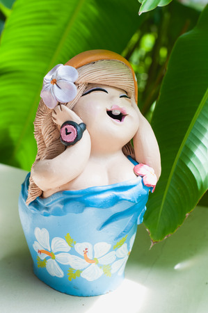 smile baby doll statue in the home photo