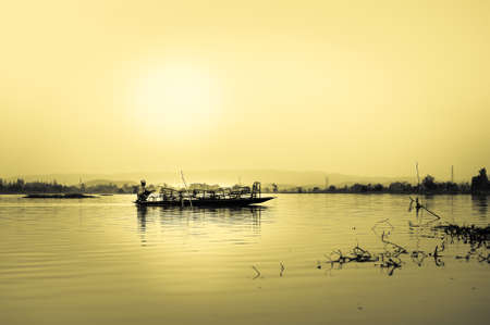 Fishermen at Nong Luang Lake in chiang rai, thailand photo