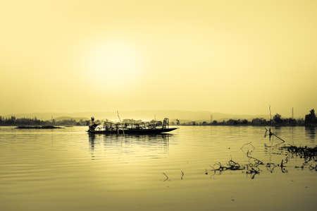Fishermen at Nong Luang Lake in chiang rai, thailand photo