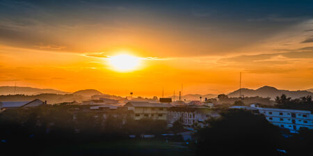 Sunset over the city, chiang rai province thailand photo