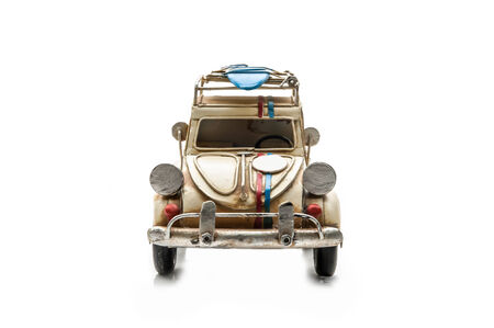 Ancient toy car isolated on white back ground photo