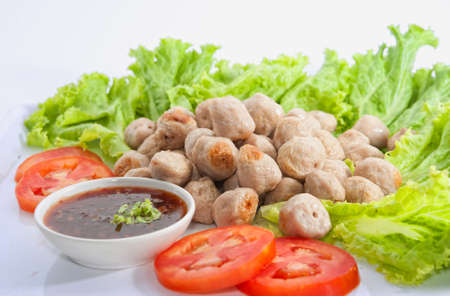 fried meat ball and vegetable on white dish photo