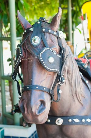 hackney carriage: artificial Horse carriages for tourist in Lampang Thailand Stock Photo