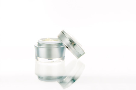 Open jar of cosmetic product on white background Stock Photo