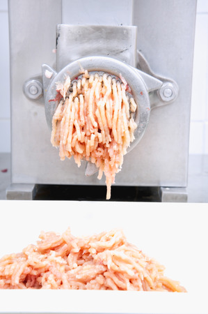 carcass meat: Mincer machine and fresh chopped meat Stock Photo
