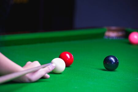 Snooker player placing the cue ball for a shot Stock Photo