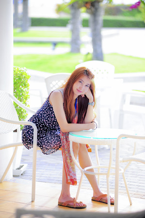 asia smile: Asia smile young woman sitting on modern white chair, relaxing