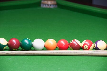 cue: Billiard ball and cue on green table