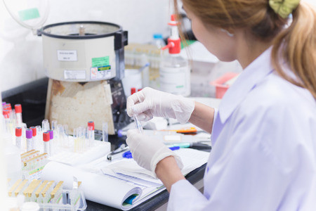 Asia women medical technology doing research in laboratory hospital