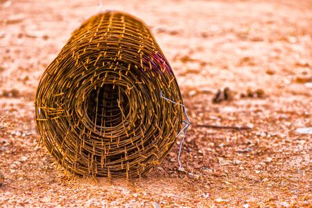 tarnish: Rusty fencing material laying on floor