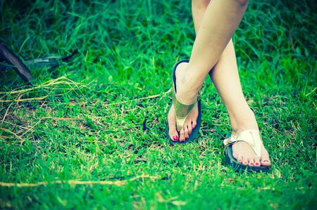 woman foot: beautiful woman foot on grass