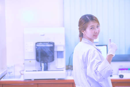 blood transfer: Portrait of asia friendly Scientist smiling giving thumbs up Stock Photo