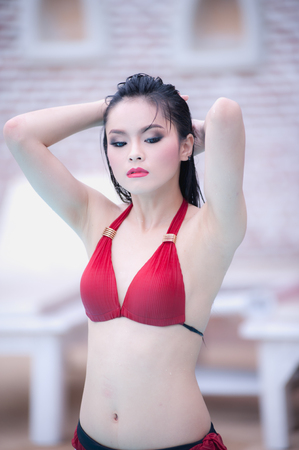 sexy young girl: asia sexy young girl standing near swimming pool