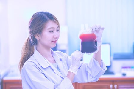 blood transfer: Bag of Blood in hand asian woman Doctor