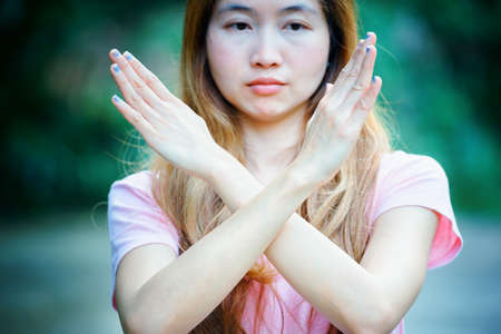 timeout: asia girl shows the hands stop timeout, women symbol concept Stock Photo