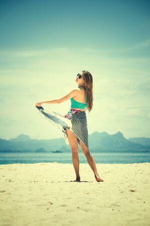 bikini island: portrait asia young woman with dress and bikini standing on Phiphi Island, krabi, Thailand Stock Photo