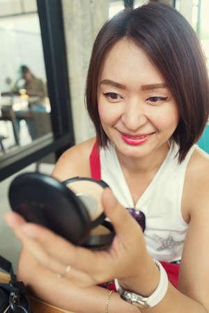 powder puff: make up woman holding powder puff