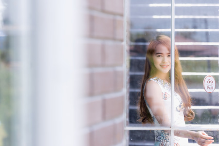 asian style: Beautiful asia young woman with opened door Stock Photo