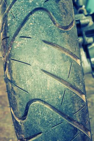 tyre tread: close up of motorcycle wheel, focus tyre