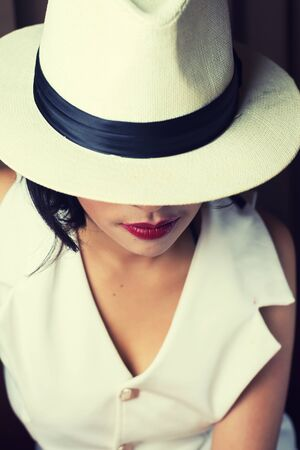 glamour girl: Portrait of beautiful young woman with white hat , vintage style