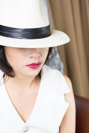 white hat: Portrait of beautiful young woman with white hat