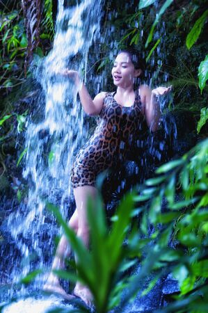 hot sexy girl: asia sexy girl under a relaxing hot spring waterfall