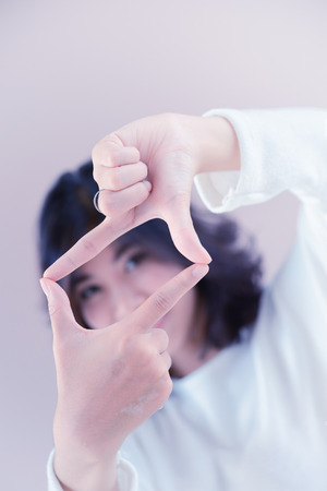 asia beutiful girl make hand symbol the frame Stock Photo