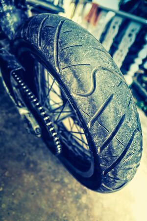 treads: close up of motorcycle wheel, focus tyre, vintage effect