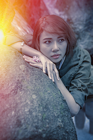 young add: Portrait of Asia Beautiful young girl stand at water fall, add flare for mood and tone style
