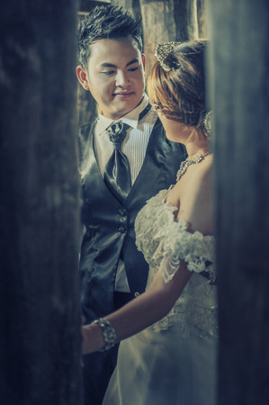 couple in love. portrait of asia young stylish fashion couple posing on outdoor. wedding style