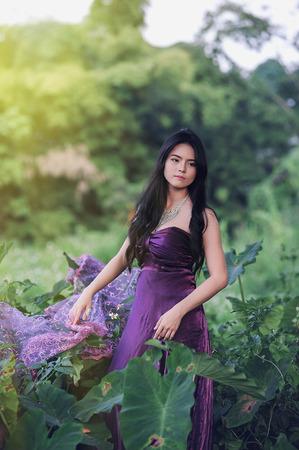 purple dress: asia Pretty girl standing   on nature in purple dress