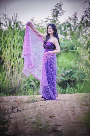 purple dress: asia Pretty girl walking on nature in purple dress