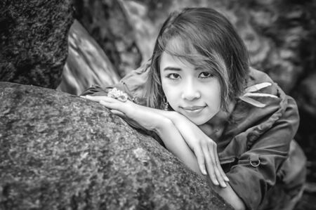 waterfall model: Portrait of Asia Beautiful young girl stand at water fall, black and white image