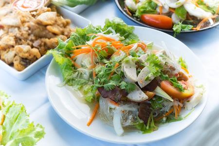 sen: yum woon sen or spicy noodle salad food thai style in restaurant