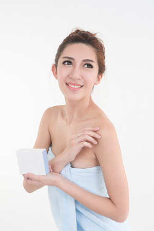 portrait of asia woman  in towel showing blank box posing on white background, beauty and healthy skin concept Stock Photo