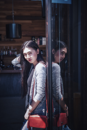 Portrait of asia beautiful lady boy with door coffee shop Stock Photo