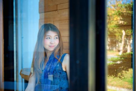 Portrait of Asia beautiful woman with door coffee shop