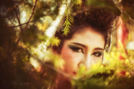 close up of asia beautiful young woman posing in forest