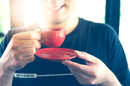 Man holding red cup of coffee, close up Reklamní fotografie