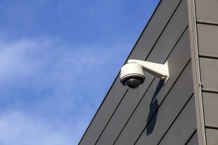 Security camera overlooking an industrial building