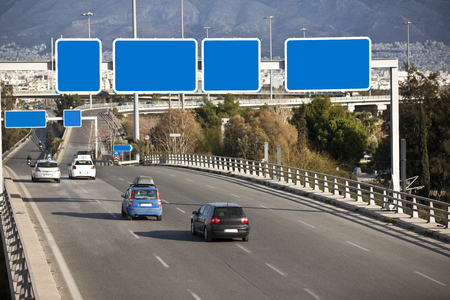 directional: Cars on highway with blank directional road signs