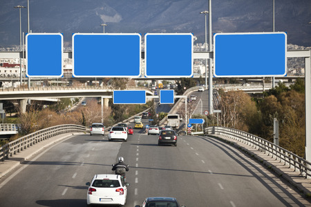 highway signs: Cars on highway with blank directional road signs