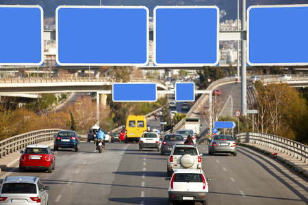 highway traffic: Cars on highway with blank directional road signs