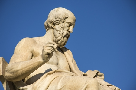 Greek philosopher Plato in front of the National Academy of Athens