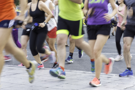 City runners ,blurred sport background