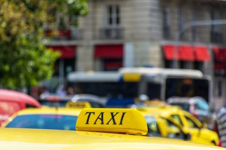 Yellow taxi sign on cab vehicle roof Stock Photo