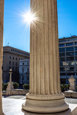 Classical marble pillars detail on the facade of National Academy of Athens, Greece