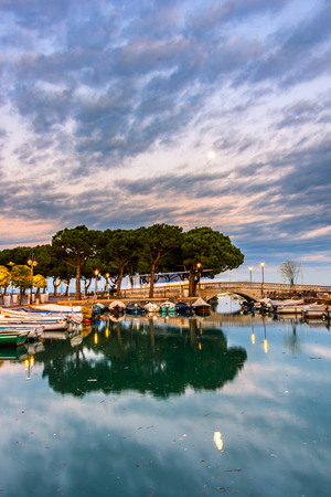 Sunset over marina at Lake Garda in Desenzano, Italy