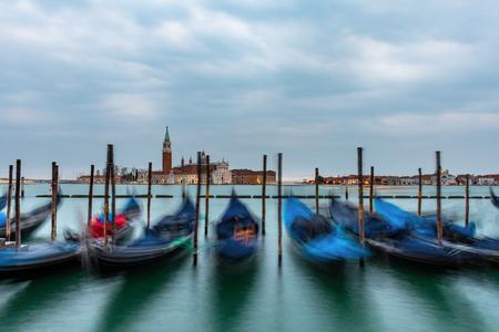 Gondolas moored in Piazza San Marco with San Giorgio Maggiore church in the background Stock fotó