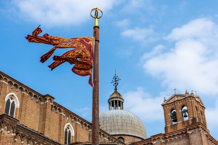 The traditional flag of Veneto Region with winged Lion, Venice, Italy